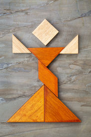 foto of tangram  - abstract figure of a female dancer built from seven tangram wooden pieces - JPG