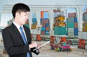 stock photo of export  - Business man using tablet to handle export and import Container transport - JPG