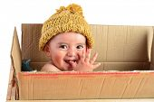 stock photo of baby delivery  - Little boy in a delivery package - JPG