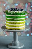 pic of cake stand  - Nice sponge happy birthday cake with mascarpone and grapes on the cake stand on festive light bokeh - JPG