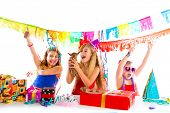 image of dog birthday  - girl friends party dancing with presents and puppy chihuahua dog in birthday - JPG