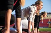 pic of race track  - business people running together on racing track - JPG