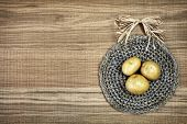 picture of doilies  - Beautiful decoration with fresh potatoes on linen doily - JPG
