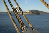 stock photo of alcatraz  - A close up of some old rope with Alcatraz Island in the background - JPG