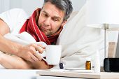 picture of sick  - Mature Sick Man Lying On Bed Having Coffee - JPG
