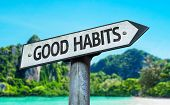 stock photo of  habits  - Good Habits sign with a beach on background - JPG