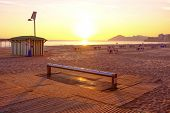 stock photo of costa blanca  - Sunset on popular beach resort Benidorm Costa Blanca Spain - JPG