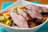 stock photo of rice noodles  - mango rice noodle salad with pork tenderloin  - JPG