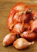 picture of red shallot  - natural organic red shallot onion on a wooden background - JPG