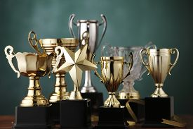 stock photo of trophy  - Group of the trophies on the green background - JPG