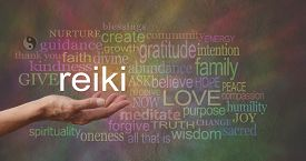 pic of senses  - Female hand outstretched with the word REIKI floating above - JPG
