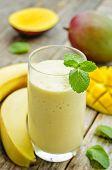 picture of mango  - banana mango smoothies on a dark wood background - JPG
