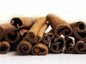 stock photo of cinnamon sticks  - Horizontal stack of cinnamon sticks on a white background - JPG