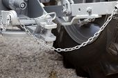 stock photo of towing  - Close up of new tractor hitch with tow bar and chains - JPG