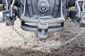 image of towing  - Close up of new tractor hitch with tow bar and chains rear view - JPG