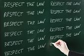 picture of punishment  - Respect the law sentence written repeatedly on blackboard as a punishment - JPG