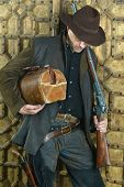 pic of gunslinger  - Bandit with gun in the wild west - JPG