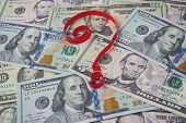 image of stagnation  - Background from dollars and question mark.  Currency and Finance - JPG