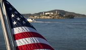 picture of alcatraz  - An American Flag with a view of Alcatraz island in the distance - JPG