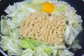 foto of boil  - Cooking noodle and vegetable close up of boiling noodles in a pot - JPG