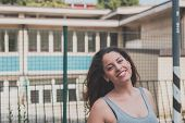 image of curvy  - Beautiful young curvy girl in tank top posing in an urban context - JPG