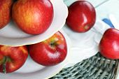 stock photo of serving tray  - Tasty ripe apples on serving tray on table close up - JPG