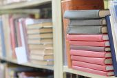 stock photo of book-shelf  - The image of books on the shelf in a library - JPG