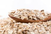picture of whole-grain  - Whole grain rolled oats flakes with wooden spoon - JPG