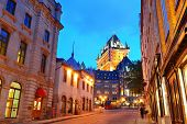 foto of chateau  - Chateau Frontenac at dusk in Quebec City with street - JPG
