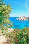 foto of shoreline  - Capo Testa shoreline on a clear day - JPG