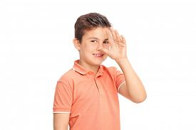stock photo of spoiled brat  - Silly little boy making a childish hand gesture and looking at the camera isolated on white background  - JPG
