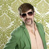 stock photo of dork  - geek retro salesperson man funny mustache sunglasses in green wallpaper - JPG