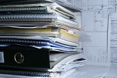 stock photo of brothel  - a lot of documents in office on table - JPG