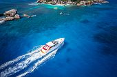 Motor boat in amazing colorful water of Seychelles Coco Island nature poster