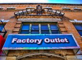 picture of thrift store  - View of sign on a factory outlet residing within an historic and beautiful building - JPG