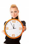 Постер, плакат: Calm Smiling Woman With Big Orange Clock Gesturing No Rush Enough Time To Be Punctual