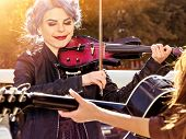 Music on violin by woman perform in park outdoor. Girl performing jazz on city street. Color tone on poster