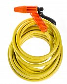 yellow garden hose coiled  with spray nozzle