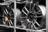 Rack with car wheels in automobile store poster
