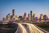 Houston, Texas, USA downtown city skyline and highway. poster