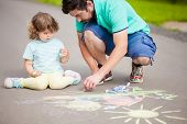 Caring Father, Happy Family. Drawing With Color Chalk. Happy Childhood. Preschooler Leisure Time. Ki poster