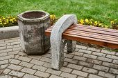 Bench Of Cement Near The Cement Urn poster