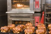 image of roast chicken  - Fresh roasted chickens in front of the oven - JPG