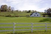 stock photo of split rail fence  - a farm with a white split rail fence - JPG