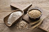 image of whole-grain  - Whole grain and flour on wooden background close up - JPG