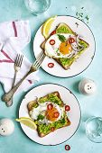 Toast With Avocado (guacamole), Fried Egg And Spices For A Brakfast On A Vintage Plate Over Turquois poster