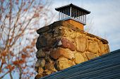 pic of chimney rock  - This is a picture of a chimney on a roof top - JPG