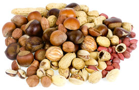 stock photo of ground nut  - mixture of various nuts isolated on white background - JPG