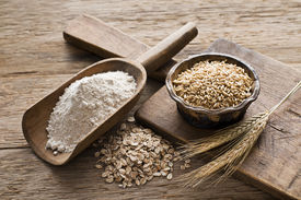 foto of whole-grain  - Whole grain and flour on wooden background close up - JPG