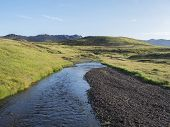 Volcanic Hills, Lush Grass And Blue River Next To Camping Site On Alftavatn Lake. Summer Sunny Day,  poster